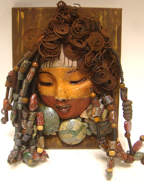 "India is mounted on a 9""x 12"" painted canvas. I spent about 4 hours or more just  fixing India's hair and attaching her beads! India has over 40 feet of 16 gauge wire for hair and over 40 raku beads. India has a amber and brown crackle face with rust brown lips. India is ready to be hung!  Free Shipping!"