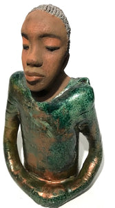 "Ivani s the third young man to be introduced in this collection.     Ivan stands 17"" x 9"" x 10"" and weighs 8.12 lbs.     Ivan has an awesome honey brown complexion.     He wears copper green hoodie     Ivan's  hair is made of  clay, black grey, and wavy.  Give Ivan a special place in your home. Free Shipping!"
