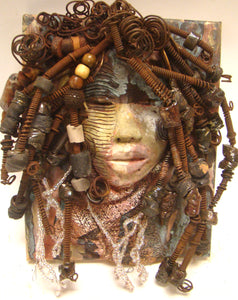 "Lakita is mounted on a 9""x 12"" painted canvas. I spent about 4 hours or more just fixing Lakita's hair and attaching beads!      Lakita has over 40 feet of 16 gauge wire for hair and over 50 raku beads.     Lakita has a pale amber and brown crackle face with rust brown  lips.     Strands of white beads, textured cloth and canvas complete her headdress.     Lakita is ready to be hung!    Free Shipping!"
