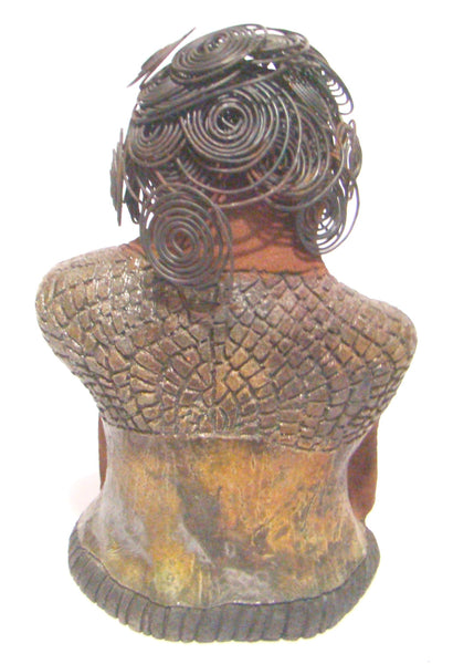 Her black curled wire hair measures over 15 feet.