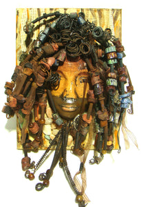 Taj has over 55 feet of  hand coiled 16 gauge  wire, over 100 hand formed   raku beads and multiple wood beads.