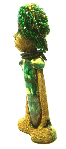 "Norway has fifty shades of green in her complexion!      She stands 12"" x 5"" x 3"" and weighs 2.3 lbs.     Norway has over 100 very small 6mm hand strung beads in her hair."