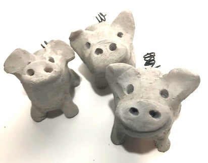 Three smokey grey raku pigs.