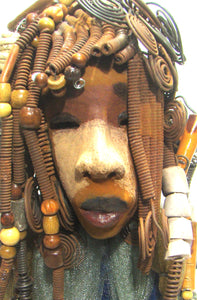 "Sabrina stands 23"" x 8"" x 5"" and weighs 9.2 lbs. She as an awesome two tone honey brown complexion. Sabrina's dress is a dark metallic blue with streaks of copper. A blue and gold tulle drapes around her neck Sabrina has long loving arms found typically on Herdew's sculptures. Sabrina sits with anticipation of being a show piece in your home especially now with her New Makeover!"