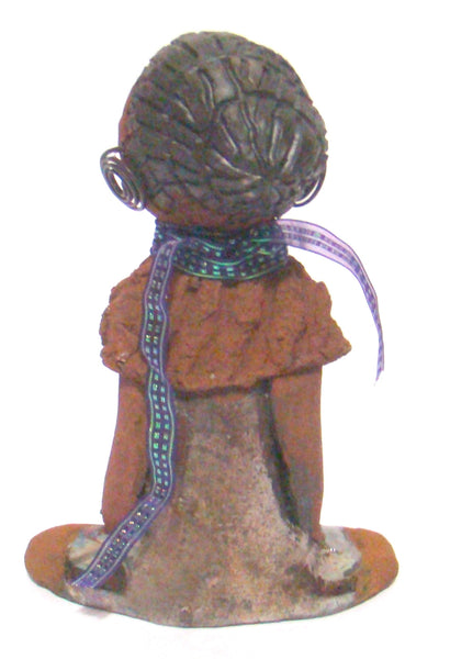 "Meet Terri!      Terri stands 9"" x 5"" x 2.5"" and weighs 1.4 lbs.     She is wearing a copper green dress with multi color iridescent ribbon necklace.     Terri has a honey brown complexion with black clay hair and wire ear rings.  She is a great starter piece for the Lester Jones art collection!"