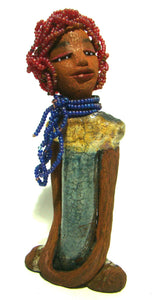 "Tiffany stands 10"" x 4.5"" x 2"" and weighs 1.05 lbs. She has a lovely honey tan complexion with purple beaded hair. Tiffany dress is glazed with blue and gold crackle. She wears a blue beaded necklace scarf."