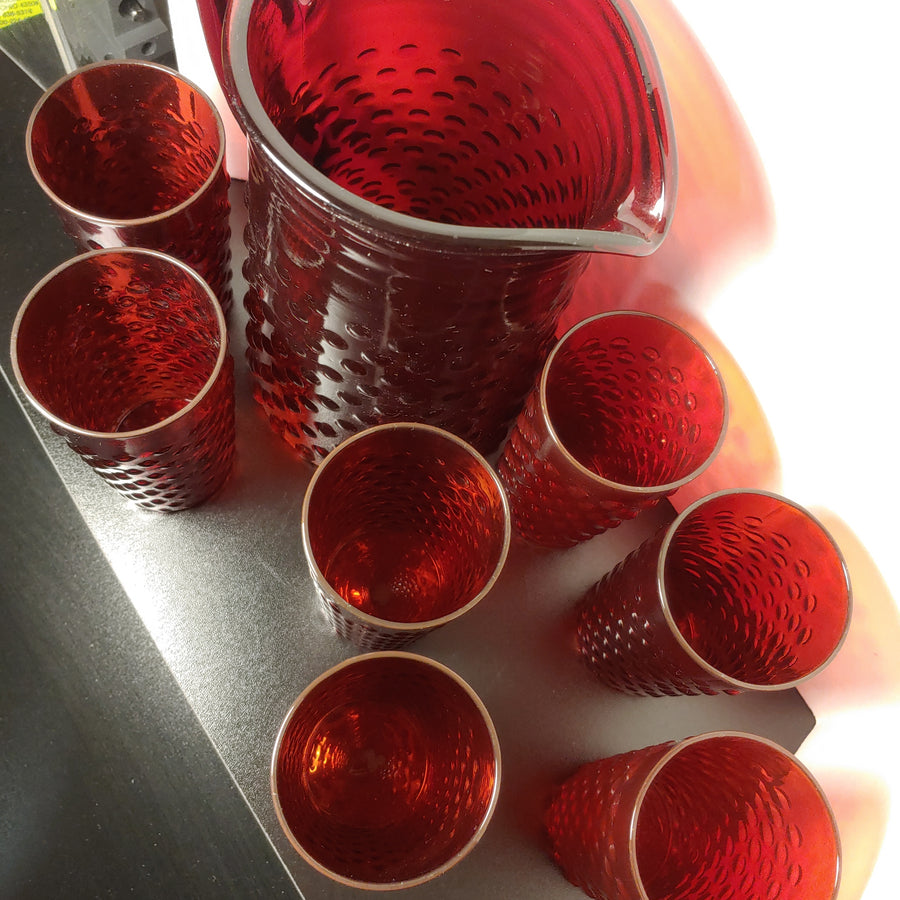 Hobnail ruby red water pitcher and 7 tumblers