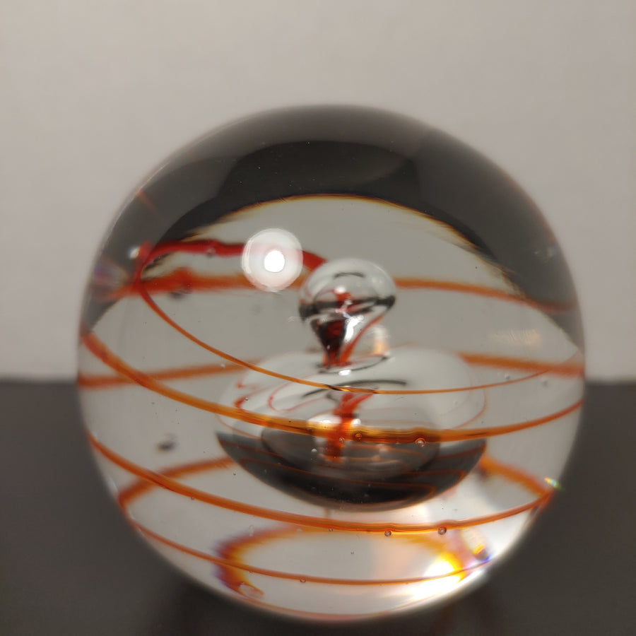 Paperweight, orange and clear