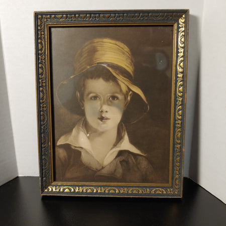 Boy with a hat print in old wood frame