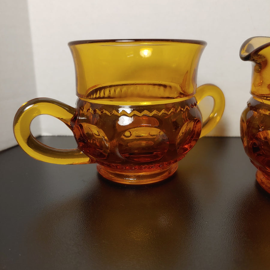 Amber, thumbprint glass sugar and creamer set