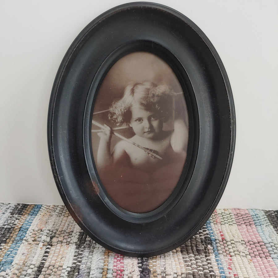 Ohio art Cupid with bow and arrow, metal oval frame