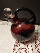 Cambridge glass, purple ball pitcher and 6 cordials