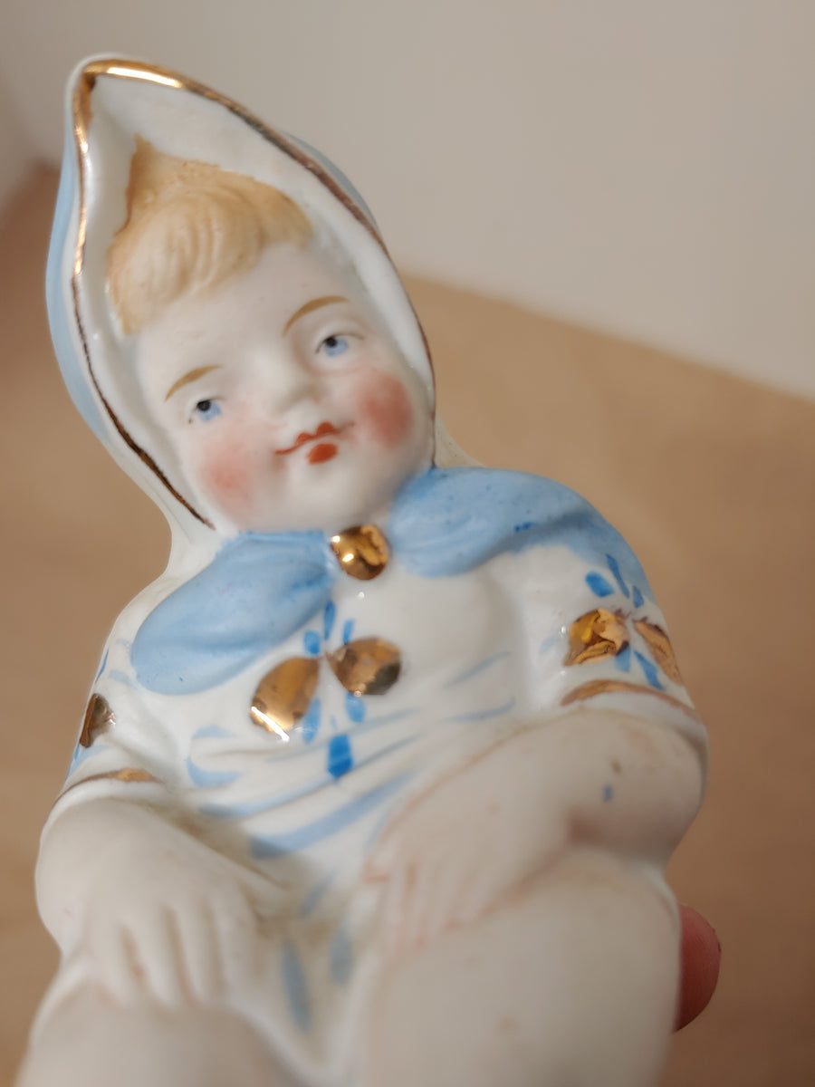 Bisque baby, chamber pot figure
