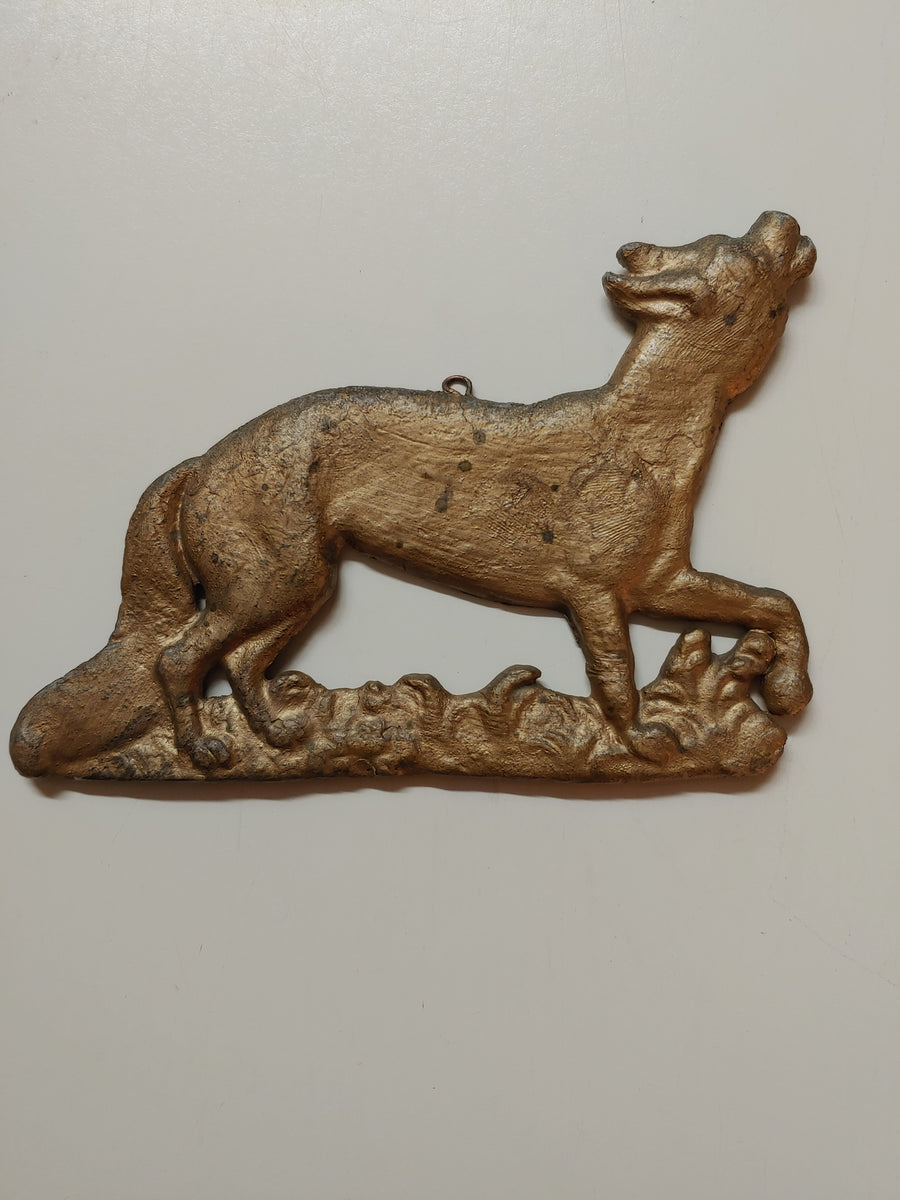 Cast iron howling coyote pair, wall hanging