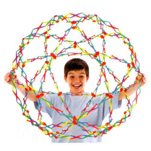 boy smiling and playing with rainbow ball