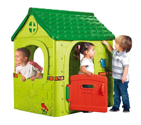 three kids playing in a cubby house