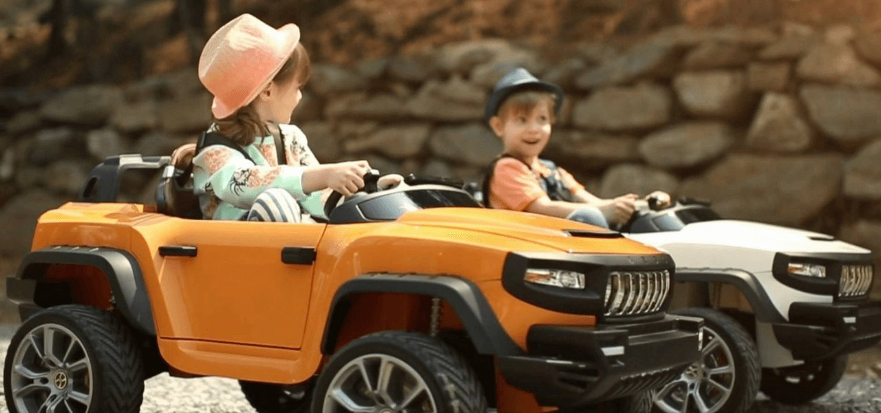 orange and white henes broon ride on kids cars