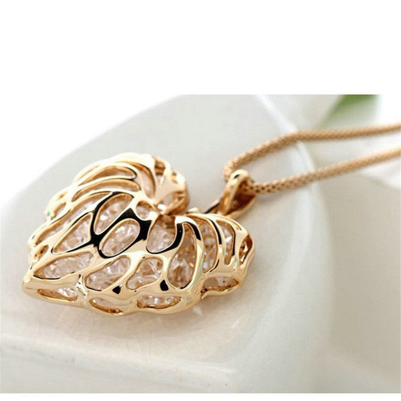 Fashion Vintage Built Sparkling Golden Hollow Zircon Love Leaves Sweater Chain Necklace