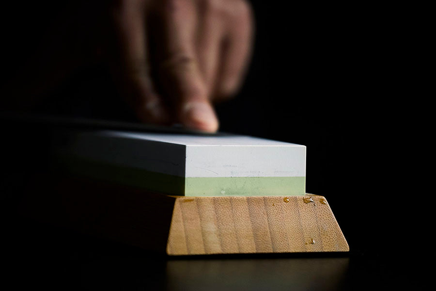 Using a whetstone on a cleaver