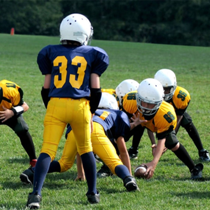 What are the advantages of using a custom sports team uniform designer?