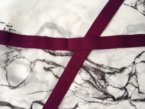 Marble with maroon ribbon