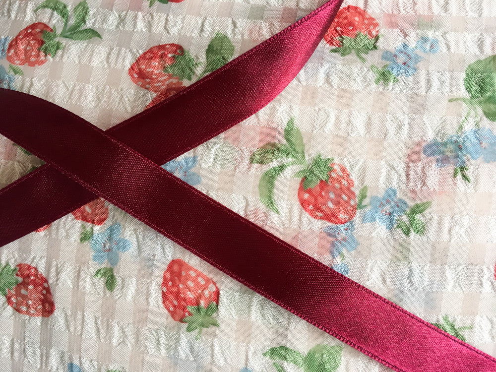 Strawberries with maroon ribbon
