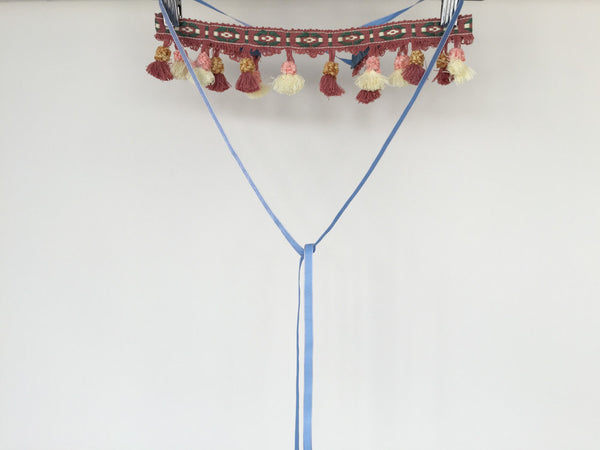 Fringe belt with blue ribbons