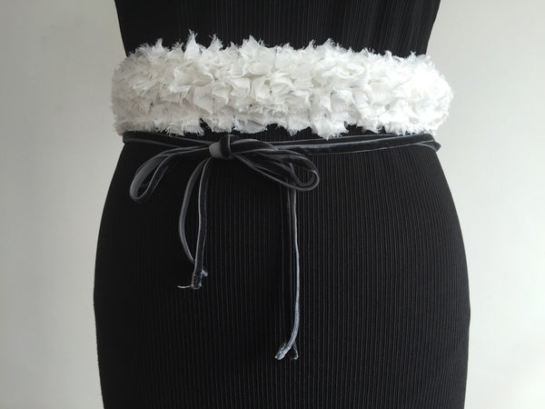 Cotton clouds with grey ribbons belt