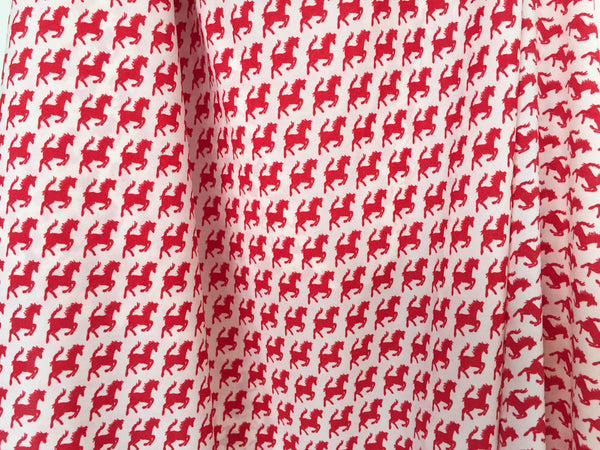 Red horses with check print ribbon