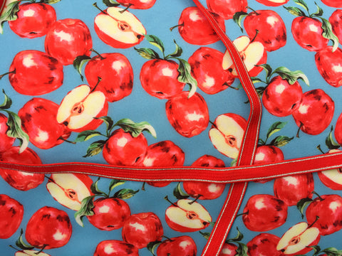 Apples with red ribbon