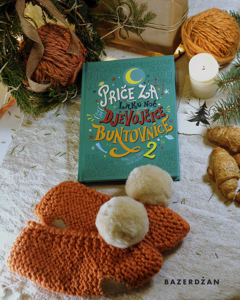 "<img src=""2020-11-16-114413345.jpg"" alt=""book goodnight stories for rebel girls and orange woolen slippers with pompom"">"