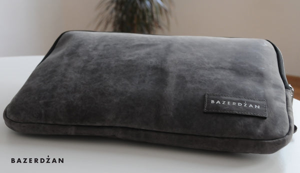 Laptop case (Color: Black, Material: Leather)