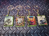 PS4 Mini Game Case Keyrings - buy 3 and get a free display stand