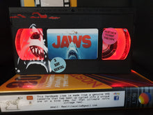 Load image into Gallery viewer, Jaws Retro VHS Lamp with Shark  and swimmer Art Work