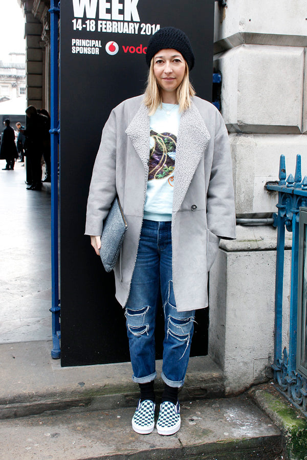 Instyle's Features Editor Hannah Rochell, london fashion week, street style, blogger style, blogger fashion, boyfriend jeans, baggy jeans, distressted denim, ripped denim, ripped jeans, jacket, sweatshirt, beanie, shoes, clutch