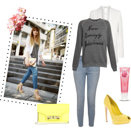How to style blue skinny jeans - London street style: blue skinny jeans from J Brand, slogan grey designer sweatshirt, white blazer, yellow shoes, yellow bag. Blogger style.