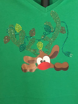 Rudolph the Red Nosed Reindeer!  He gets tangled in some rhinestone Christmas Lights.