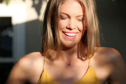 Blonde haired model in yellow cami wearing a genuine amethyst stone gold necklace - MaeMae Jewelry