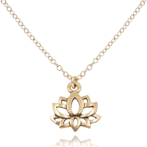 Close up of a gold pewter lotus charm on a 14k gold filled necklace on white background - MaeMae Jewelry
