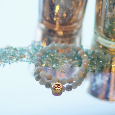 Lifestyle of Aquamarine Stone Bracelet on mirror background with seaglass