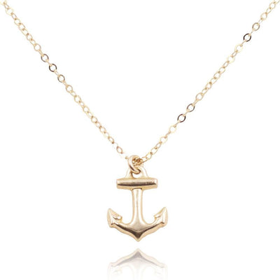 Close up of a dainty 14k gold filled anchor charm on a necklace - MaeMae Jewelry