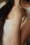 Model wearing Bliss Gold Bracelet MaeMae Jewelry