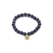 Blue Goldstone Stretch Bracelet with Gold Pewter Lotus Charm
