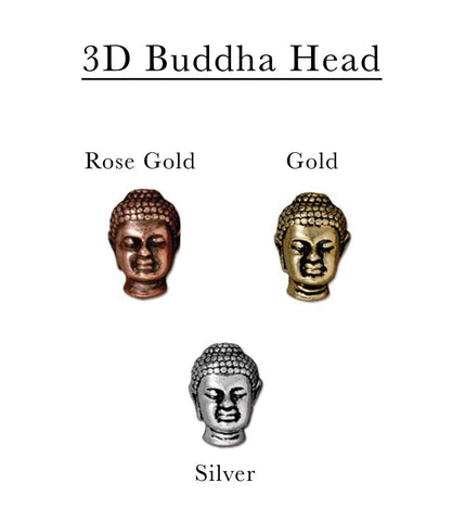 Three pewter Buddha Head Charms in Rose gold, yellow gold, and silver