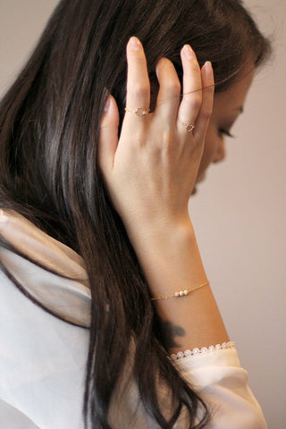 Model wearing 14k gold filled bracelet with tricolored stardust beads - MaeMae Jewelry