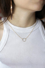 Model wearing MaeMae's Everything Happens For A Reason Necklace in a 14K Gold Fillled Finish.