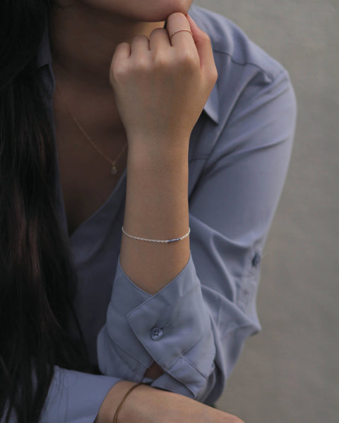 Model wearing Flow Bracelet in Silver