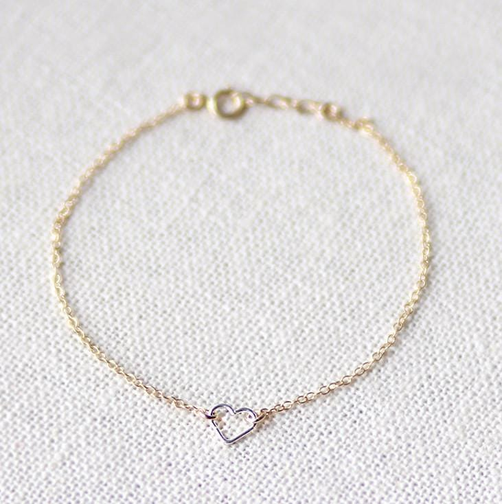 Model wearing 14k gold filled chain bracelet with sterling silver open heart charm - MaeMae Jewelry