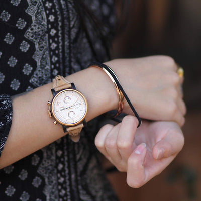 Woman wearing Maengle hair tie bangle with fossil watch - MaeMae Jewelry