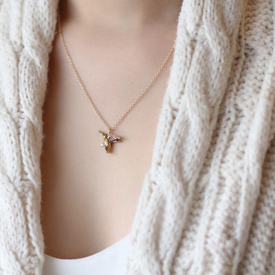 Model lifestyle wearing hummingbird bird charm with white pearl for mom mother's day  in 14k gold filled chain necklace mother's day mom affirmation - MaeMae Jewelry
